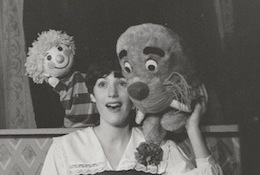Colleen singing with the puppets in 'Carnival'.